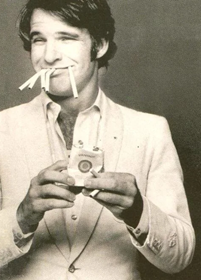 Comedian Steve Martin in the 1970s with several bent cigarettes in his mouth